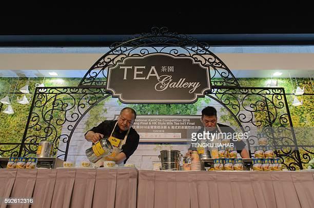 In this photograph taken on August 13 Guangzhou regional tea-making champion Bi Run-chao and Shanghai champion Liang Yuan-hui compete in the Hong...