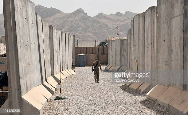 In this photograph taken on August 13 rows of concrete blast walls are set up at the joint USAfghan combat outpost of the 287 Infantry Battalion 3rd...