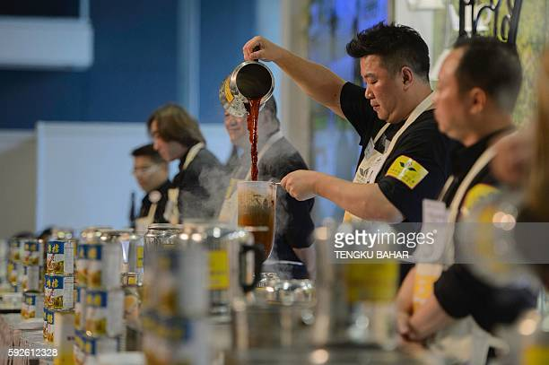 In this photograph taken on August 13 Shanghai regional tea-making champion Liang Yuan-hui pours his brew as he competes with other participants in...