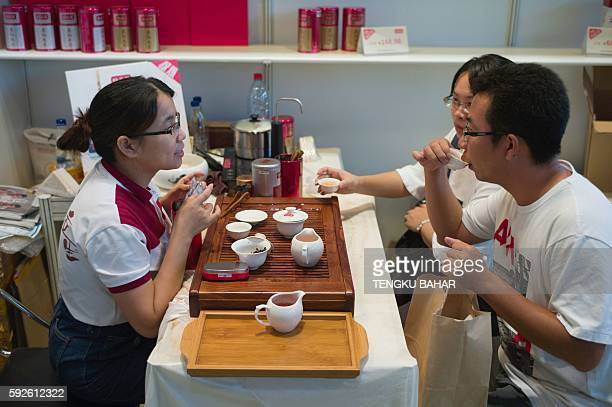 In this photograph taken on August 13 visitors sample tea from a floor exhibitor during the 2016 Hong Kong International Tea Fair Some cities are...