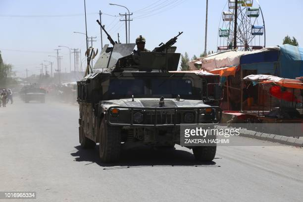 In this photograph taken on August 14 Afghan security forces patrol along a road in the city of Ghazni Afghan forces appeared to have finally pushed...