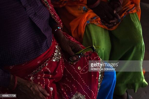 In this photograph taken on August 14 Indian patients wait to undergo eye examinations at the Dr Shroff Charity Eye Hospital Vision Centre in...