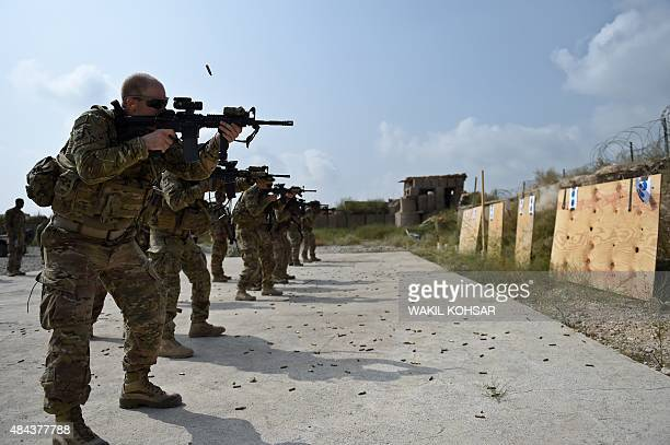 In this photograph taken on August 14 US army soldiers fire during a military exercise inside coalition force Forward Operating Base Connelly in the...