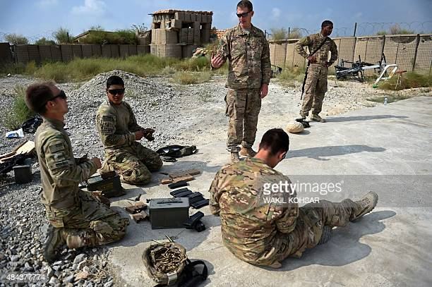 In this photograph taken on August 14 US army soldiers load ammunition into rifles during a military exercise inside coalition force Forward...