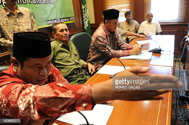 STORY 'INDONESIARIGHTSMASSACRECOMMUNISM' BY In this photograph taken on August 15 a group representing Indonesia's retired military commanders and...