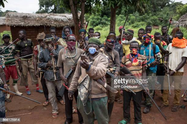 In this photograph taken on August 16 antiBalaka combattants patrol in the parish of Gambo southeastern Central African Republic On 13 May 2017...