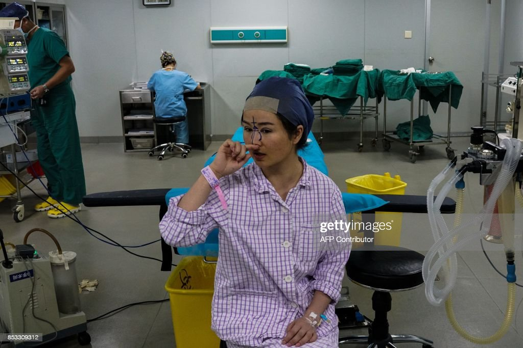 In this photograph taken on August 22, 2017, Chen Yan, 35, prepares for her plastic surgery procedure at Huamei Medical Cosmetology Hospital in Shanghai. Plastic surgery is booming in China, fuelled by rising incomes, growing Western influences and the imperative of looking good on social media. / AFP PHOTO / CHANDAN KHANNA / To go with AFP story China-Lifestyle-Health-Social-Plastic, Feature by Peter Stebbings with Morgan Huang