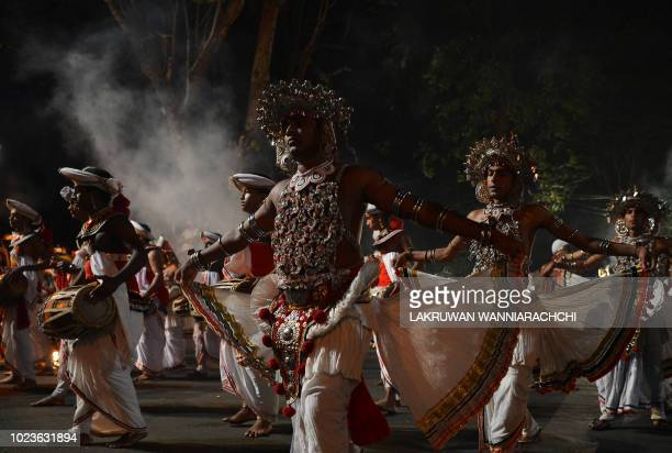 In this photograph taken on August 25 Sri Lanka's traditional dancers perform in front of the historic Buddhist temple of the Tooth, as they take...
