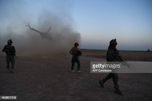 In this photograph taken on August 27, 2017 Afghan Commandos participate in a combat training exercise at Shorab Military Camp in Lashkar Gah in...