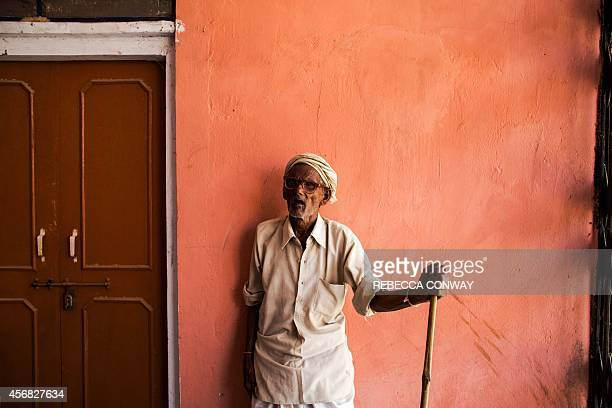 In this photograph taken on August 28 an Indian resident waits to be seen at the Dr Shroff Charity Eye Hospital vision field camp in Chilori village...