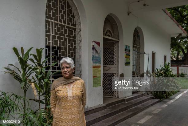 In this photograph taken on August 3 Indian Partition survivor Madhu Sondhi speaks during an interview with AFP at the home where she lived during...