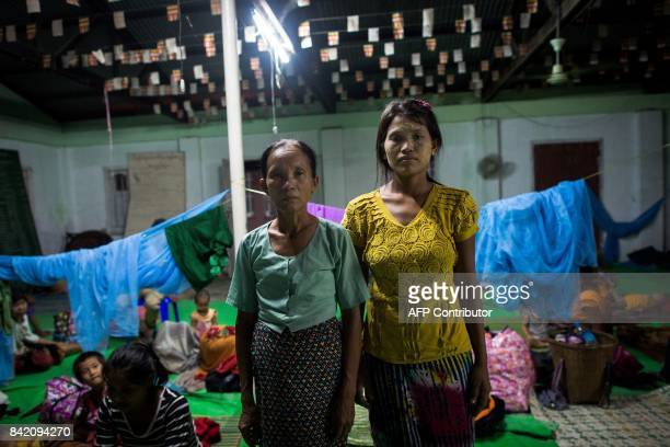 In this photograph taken on August 30 Soe Soe a Rakhine who was born and raised in Bangladesh poses for a portrait with her motherinlaw at an...