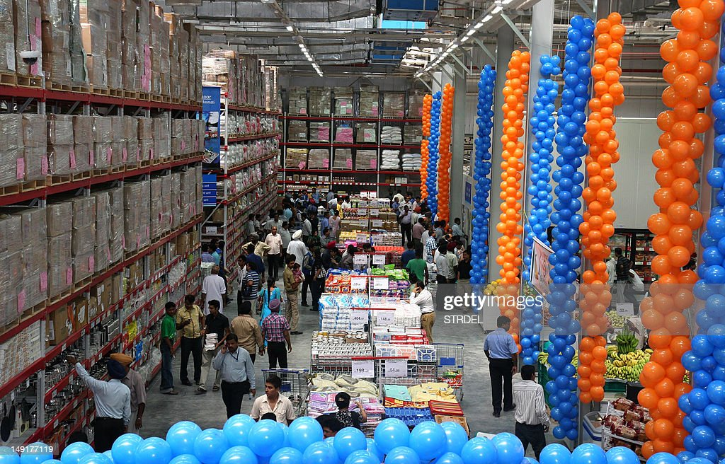 In this photograph taken on August 4 2010 Indian wholesale customers browse the newlyopened WalMart outlet in northwestern Punjab state`s Jalandhar...