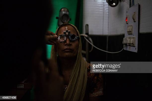 In this photograph taken on August 4 an Indian patient undergoes an eye examination at the Dr Shroff Charity Eye Hospital Vision Centre in Mustafabad...