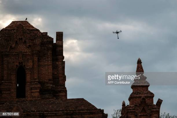 In this photograph taken on August 5 a drone flies a 360 4K video camera over the ancient city of Bagan as a team of virtual reality experts document...