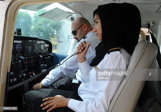 In this photograph taken on August 6 eighteen year old Pakistani female flying student Qadar Sarfraz communicates with air traffic control as she...