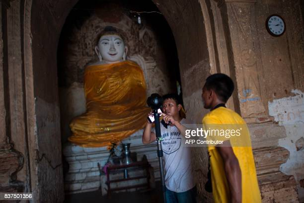 In this photograph taken on August 6 Nyi Lin Seck and another member of his team set a 3604K video camera with which they are documenting the...
