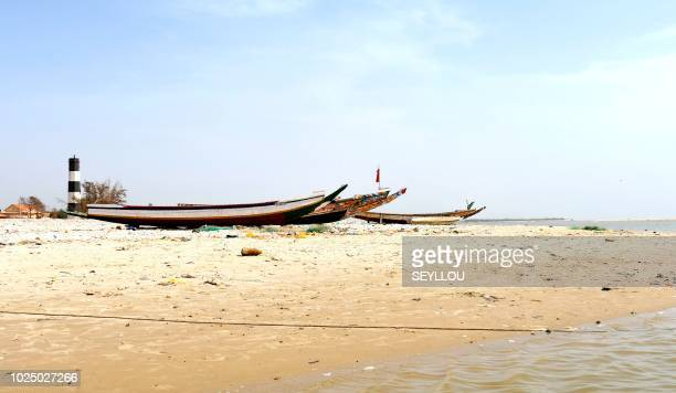 In this photograph taken on August 8 fishing boats stand on a sandy beach of Ndiebene-Gandiol near the northern Senegal city of Saint-Louis. - In...