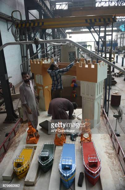 In this photograph taken on August 8 Pakistan railway employees prepare a float decorated to mark the ChinaPakistan Economic Corridor as part of the...