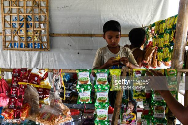 In this photograph taken on August 8 Rohingya refugee children set up a makeshift shop in the Kutupalong camp in Cox's Bazar The Bangladeshi district...