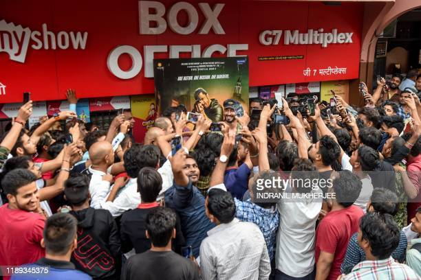 In this photograph taken on December 1 Bollywood actor and stunt performer Vidyut Jamwal is mobbed by media and fans outside a cinema in Mumbai As a...
