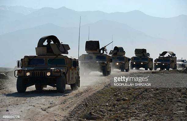 In this photograph taken on December 1 members of the Afghan security force patrol during an ongoing operation against Islamic state groups in Achin...