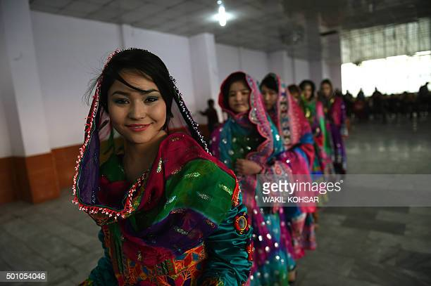 In this photograph taken on December 11 2015 Afghan women wear traditional dress at a fashion show in Kabul The show organized by the Seven Leaves of...