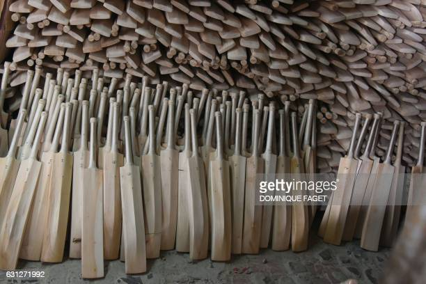 In this photograph taken on December 14 finished cricket bats stand awaiting labelling in a factory in Meerut some 70kms northeast of New Delhi As...