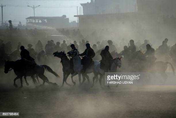 In this photograph taken on December 15 Afghan horsemen compete during a game of the traditional sport of Buzkashi in MazariSharif The ancient game...