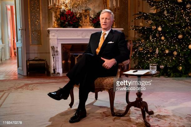 In this photograph taken on December 18 King Philippe of Belgium gestures as he delivers his yearly Christmas message at The Royal Palace in...