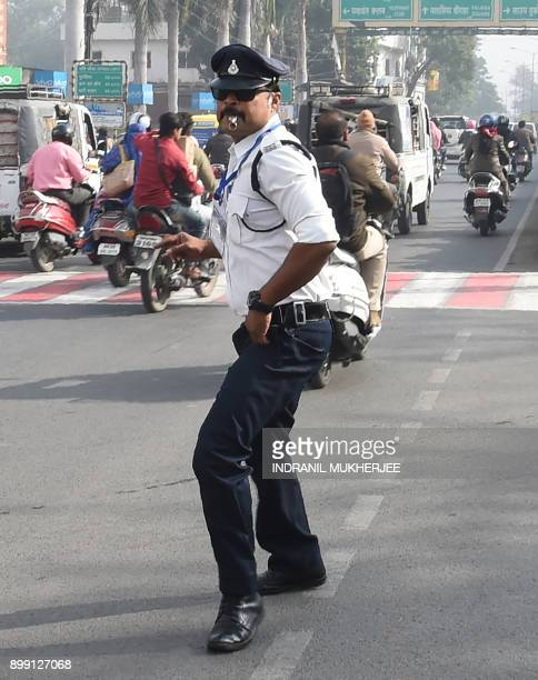 In this photograph taken on December 22 Indian traffic policeman Ranjeet Singh directs traffic while moonwalking at an intersection in Indore He is...