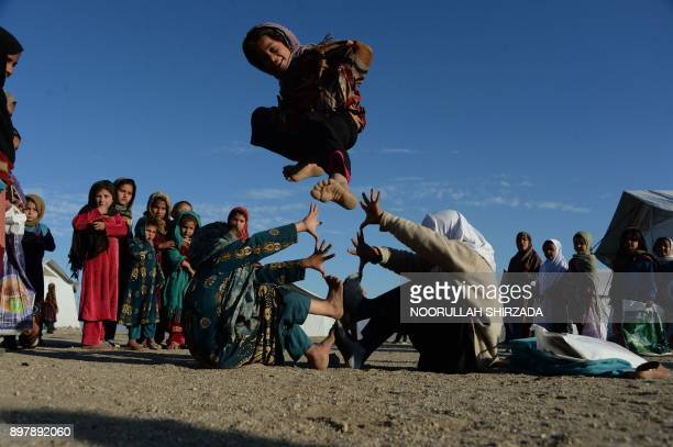 TOPSHOT In this photograph taken on December 23 2017 Afghan school children play at an openair school at the Gambiri Refugee Camp in Laghman province...