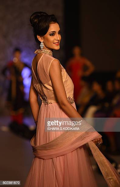 In this photograph taken on December 23 an Indian model presents a creation at an International Fashion Fest fashion show in Colombo AFP PHOTO/...