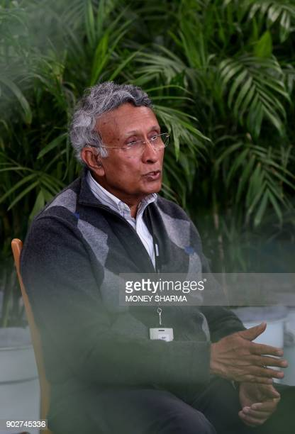 In this photograph taken on December 27 Indian environmentalist Kamal Meattle speaks during an interview with AFP in the greenhouse at his office in...