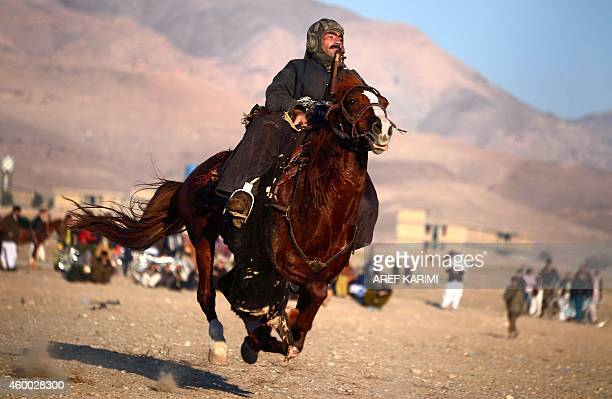 In this photograph taken on December 5 2014 an Afghan horseman competes during the traditional sport of Buzkashi in Herat Province The ancient game...