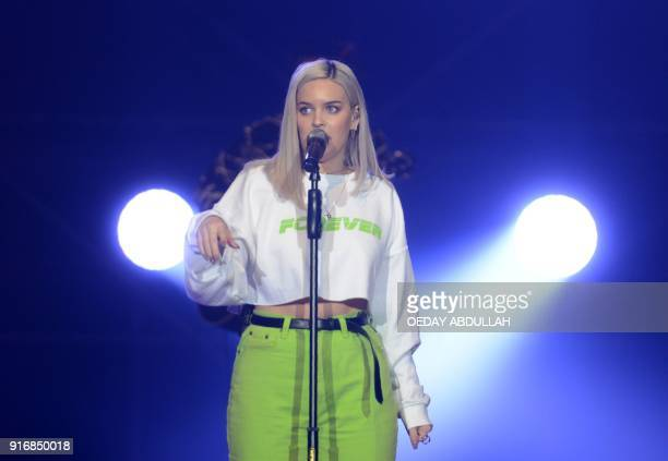 In this photograph taken on February 10 Indonesian singersongwriter AnneMarie performs at a concert in Jakarta / AFP PHOTO / Oeday Abdullah