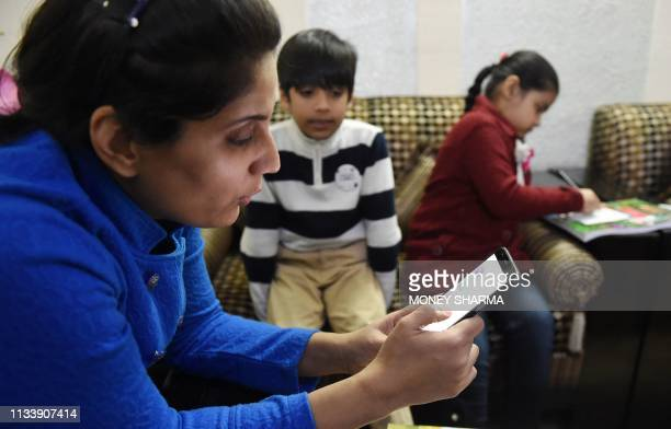 In this photograph taken on February 13 Ruchi Taneja teaches a group of Indian children studying with an app created by Planet Sparks that uses...