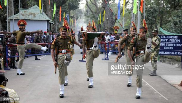 In this photograph taken on February 14 Indian Border Security Force personnel march past with the tricolour flag during the Beating Retreat ceremony...