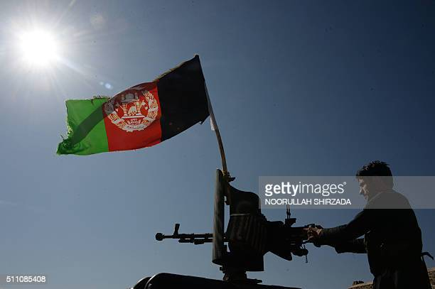 TOPSHOT In this photograph taken on February 17 a member of the Afghan security forces patrols after an operation against Islamic State militants in...