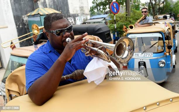 In this photograph taken on February 26 American jazz musician Wycliffe Gordon and fellow perfomers take part in a street performance in the Sri...