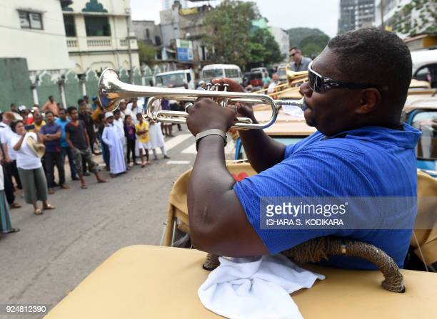 In this photograph taken on February 26 American jazz musician Wycliffe Gordon takes part in a street performance in the Sri Lankan capital Colombo...
