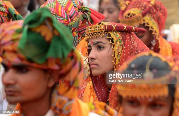 In this photograph taken on February 3 an Indian bride looks on as she participates in a mass wedding ceremony of the Thakore community in the...