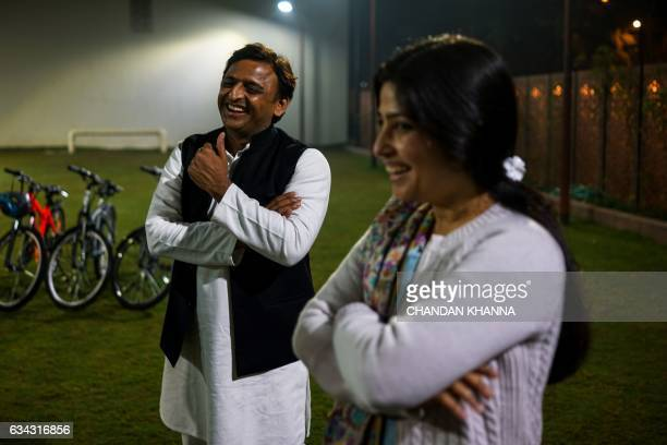 In this photograph taken on February 3 Uttar Pradesh state Chief Minister Akhilesh Yadav shares a light moment with his wife and member of Indian...