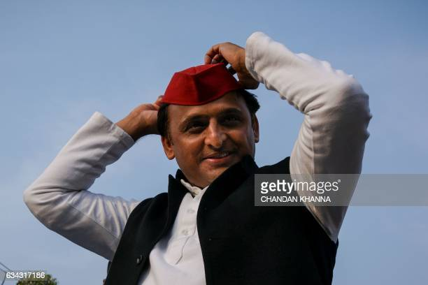 In this photograph taken on February 3 Uttar Pradesh state Chief Minister Akhilesh Yadav adjusts his cap during a election rally in Agra Five Indian...
