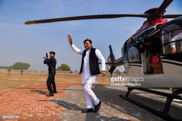 In this photograph taken on February 3 Uttar Pradesh state Chief Minister Akhilesh Yadav waves to the crowd at a public rally in Bah in the district...