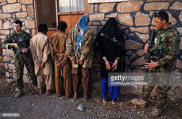 In this photograph taken on February 5 Afghan security personnel present four suspected Taliban fighters to the media at the Afghan National Army...
