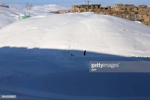 In this photograph taken on February 5 an Afghan man walks through heavy snow in Ghazni province Heavy snowfall over the last week has caused...