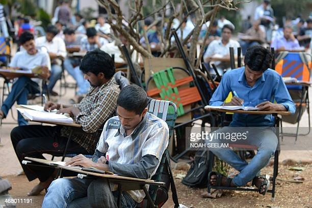 In this photograph taken on February 7 2014 Indian students prepare for competitive exams in an open space of the City Central Library in Hyderabad...