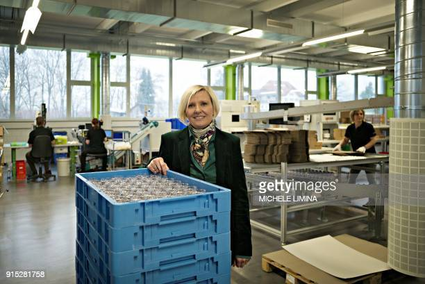 In this photograph taken on February 7 Andrea Berlinger CEO and President of Berlinger AG poses at Berlinger AG facility in Ganterschwil where the...