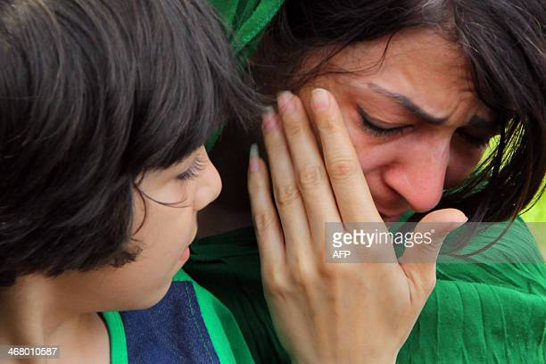 In this photograph taken on February 8 a detained woman and child asylum seeker from Pakistan gather at a hotel in Tasikmalaya in western Java island...